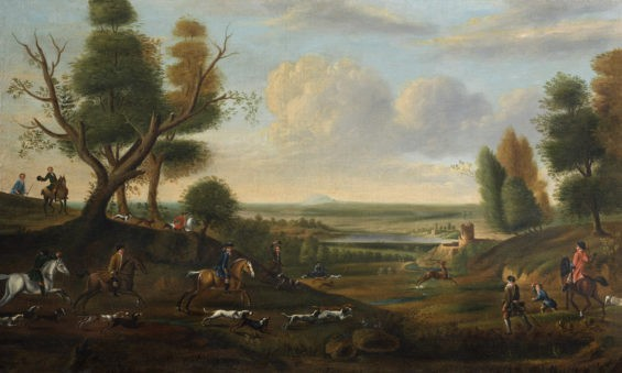 A Hunting Scene with hounds chasing a stag across an open landscape, a river and town beyond